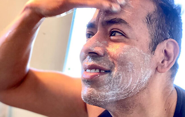 man with facial product