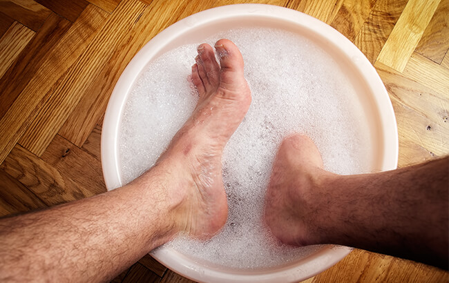 man soaking feet